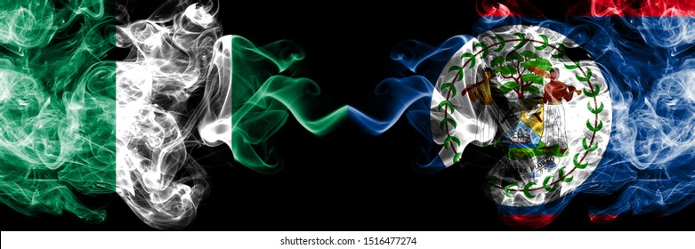 Nigeria vs Belize, Belizean abstract smoky mystic flags placed side by side. Thick colored silky smoke flags of Nigerian and Belize, Belizean