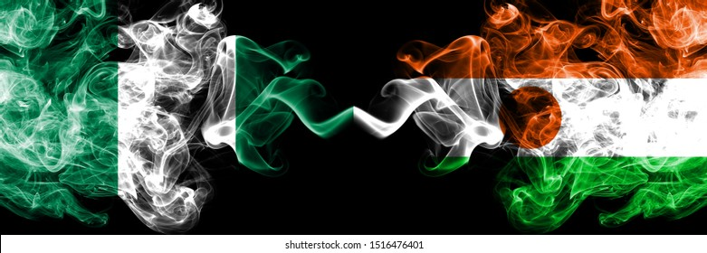 Nigeria vs Niger, Nigerian abstract smoky mystic flags placed side by side. Thick colored silky smoke flags of Nigerian and Niger, Nigerian