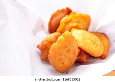 Nigerian Akara also called Kwosai or Acarajé in Portuguese a West African and Brazilian cuisine for street food. Fried beans cakes, Bean Balls, Bean Fritas served in white paper