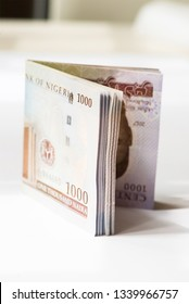 Nigerian Currency - A folded wad of 1000 Naira notes