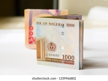Nigerian Currency - A folded wad of 500 and 1000 Naira notes