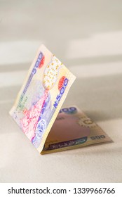 Nigerian Currency - A folded wad of a single 500 Naira note