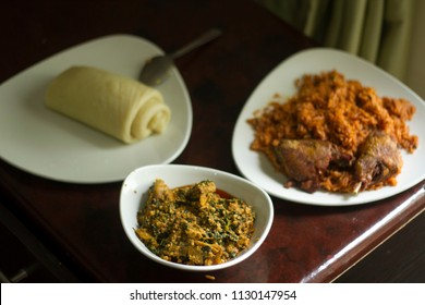 Nigerian Food: A Plate of swallow and Egusi soup with Jollof Rice and Chicken
