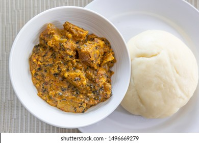 Nigerian Pounded Yam served with Spicy Bitterleaf soup
