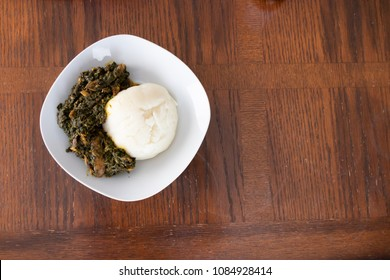 Nigerian Vegetable Soup Served with Pounded Yam
