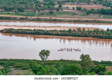 Nigerien fishermen fishing on their boats in Niger river during sunset in Niamey in Niger in Africa