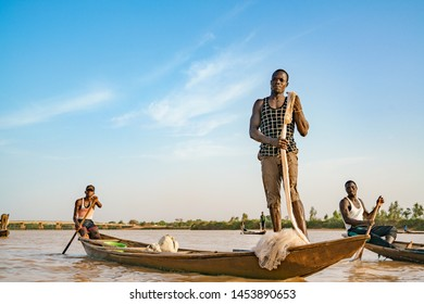 Nigerien fishermen fishing on their boats in Niger river during sunset in Niamey in Niger in Africa 25 June 2019