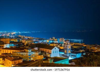 Nigh lights Salerno landscape on dusk