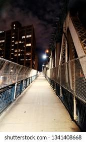 Nigh point of view empty pedestrian bridge, color.