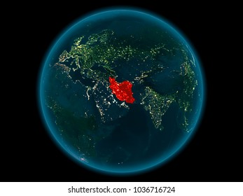 Night above Iran highlighted in red on model of planet Earth in space. 3D illustration. Elements of this image furnished by NASA.