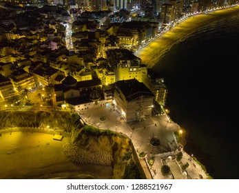 Night Aerial photo of Benidorm Playa Levante beach, hotels, buildings, restaurants and the coastline and sandy beaches of Benidorm the seaside resort in Spain Alicante.