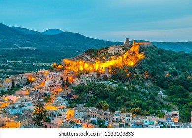 Night aerial view of Capdepera castle and Capdepera town, Mallorca, Spain