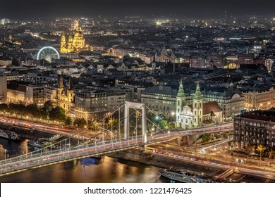 Night aerial view of the Pest side of Budapest across the Danube River in Hungary, Europe.