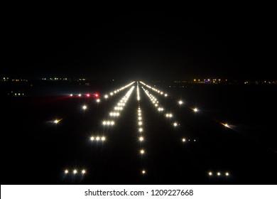 Night airport runway. Runway lights and PAPI-lights.