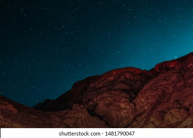 Night Astrophotography of the beautiful El Towaylat Mountain with the sky lit up by the stars in Dahab, South Sinai, Egypt in the middle of the Red Sea desert.
