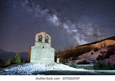 Night Astrophotography. Milky Way over Sant Quirc of Durro Romanesque hermitage, Pyrenees,, Vall de Boi, Lleida, Catalonia, Spain