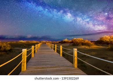 Night Astrophotography: Milky way over   Riumar beach within Delta de Ebro natural park, Tarragona, Catalonia, Spain, soft focus