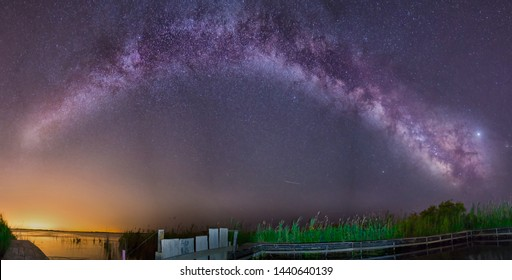 Night Astrophotography: Milky  way over over a pier in Delta de Ebro natural park, Tarragona, Catalonia, Spain
