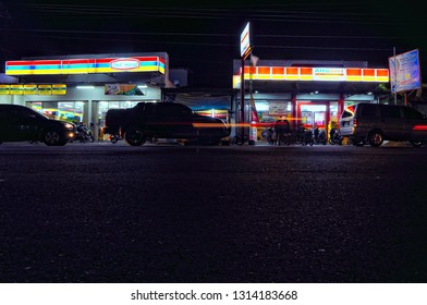 the night atmosphere of the minimarket on Jalan Ngalian, Semarang City, Central Java, Indonesia, (28 July 2013, Sunday)