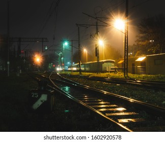 Night atmospheric photo of the station and railway wagons.