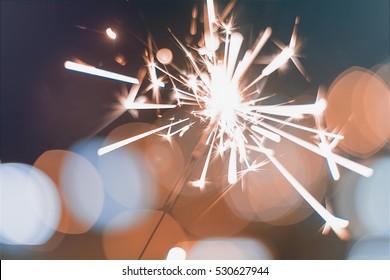 Night background with a sparkler. Sparkler  Bokeh  Colorful sparkler.
