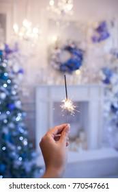 Night background with a star christmas sparkler. Sparkler Bokeh Colorful sparkler. Shallow focus