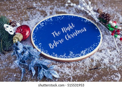 The Night Before Christmas Written In Chalk On Blue Chalkboard Holiday Sign Background With Snow And Decorations.