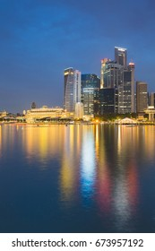 Night blue twilight Singapore city office building seafront with reflection light, cityscape background