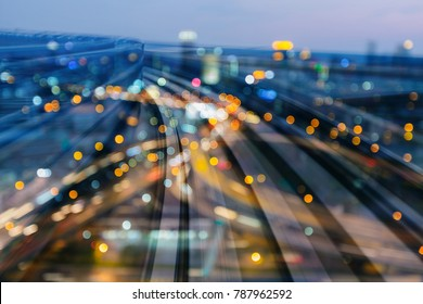 Night blurred light city office building double exposure moving train track, abstract background