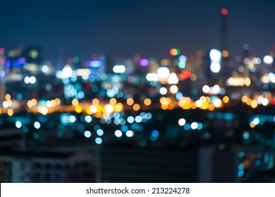 Photo of Night bokeh light in big city, abstract blur defocused background.