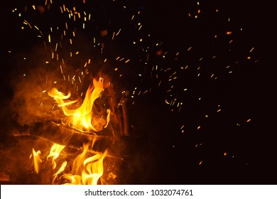 Night bonfire with sparks. Fire background with copyspace