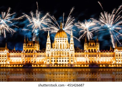 Night Budapest with fireworks parliament building with reflection. concept of holiday background