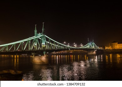 Night Budapest. Liberty Bridge or Freedom Bridge in Budapest, Hungary, connects Buda and Pest across the River Danub illuminated at night.