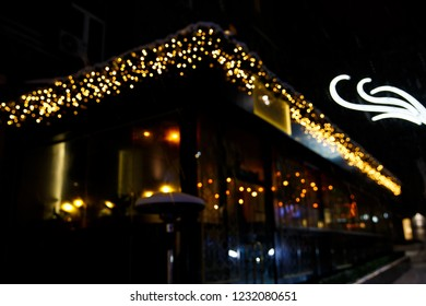 Night christmas cafe. Blurred photo