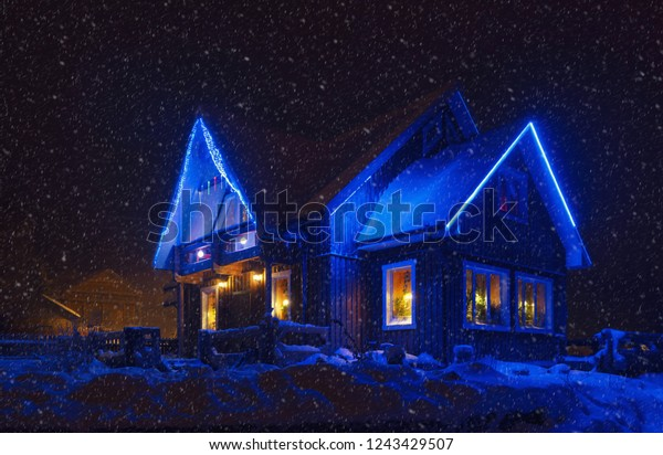 Snowing Christmas Lights.Night Christmas Decorated Country House Christmas Stock