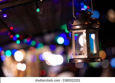 night Christmas fair soft focus lantern on blurred unfocused colorful bokeh lights, copy space
