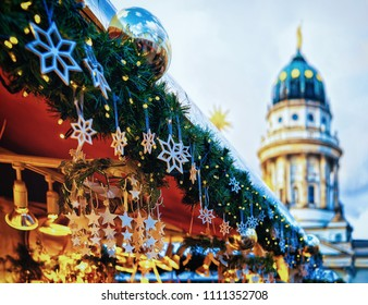Night Christmas Market in Gendarmenmarkt at Winter Berlin, Germany. Advent Fair Decoration and Stalls with Crafts Items on the Bazaar.