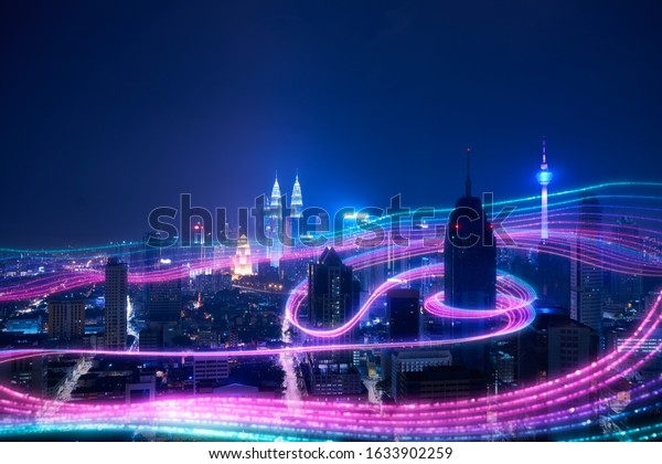 Night city and abstract with gradient blue and red glowing light trail surround the city ,Smart city big data connection technology concept .