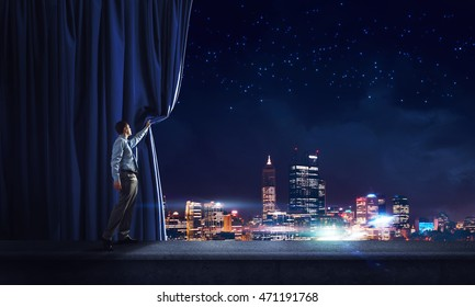 Night city behind curtain