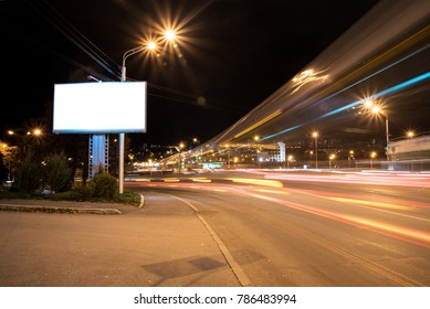 Night city Billboard, followed by the lights of cars and buses