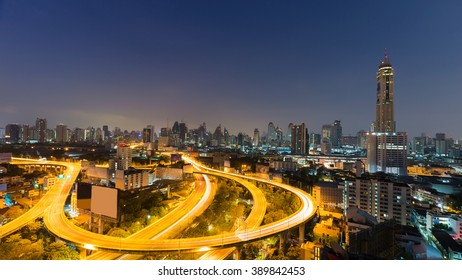 Night city highway and downtown background before sunrise, Thailand