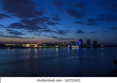 Night city landscape with a river view