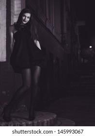 Night city life, female fashion portrait