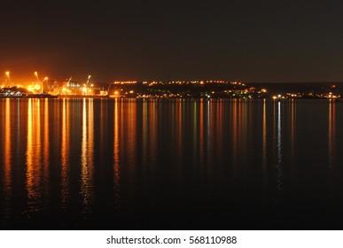 night city light tracks in water