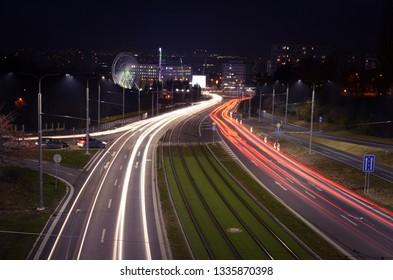 Night city lights car light trails