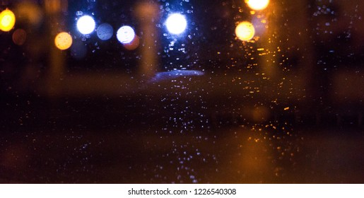 Night city, neon lights, blurred bokeh background, raindrops. Night view.