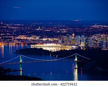 Night City and Ocean View.  Metro Vancouver, Port of Vancouver and Lions Gate bridge. View from Cypress Mountain. British Columbia, Canada.
