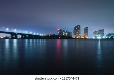 Night city, reflection in water