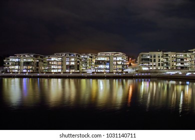 night city scape with reflections on the water
