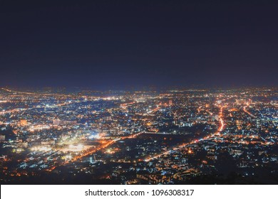 Night city scape at top view point of Chiang Mai, Thailand.